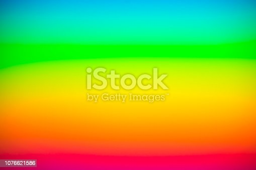 istock rainbow background. blurred colorful background design. 1076621586