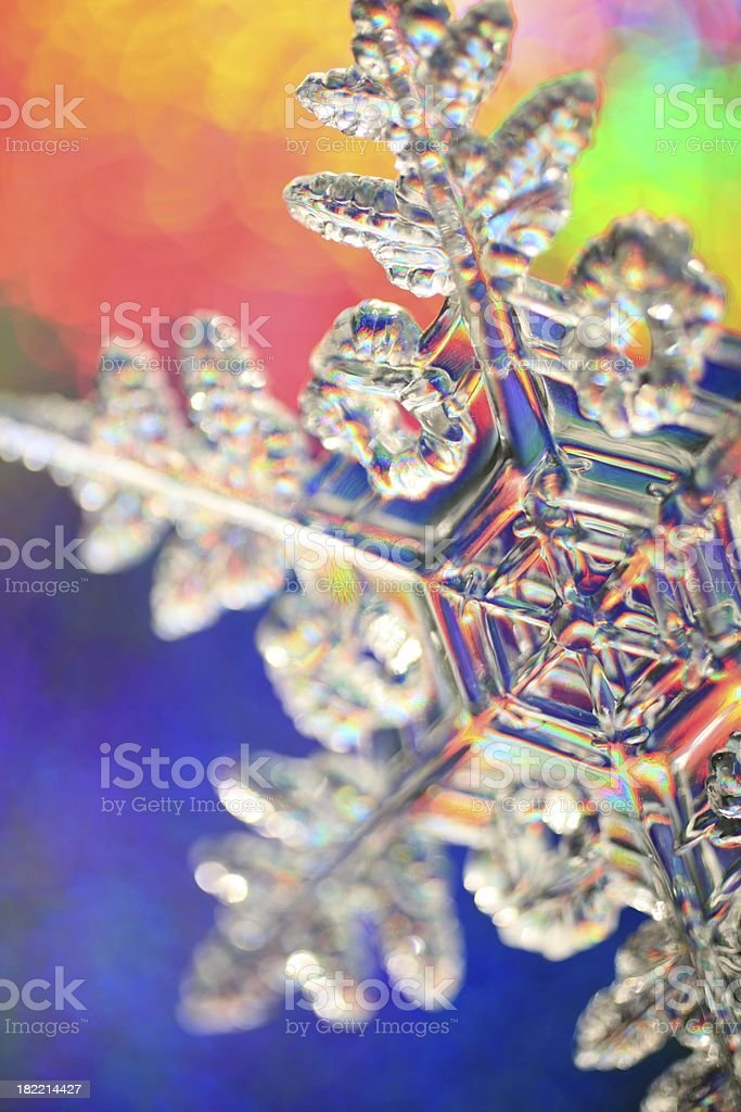 Rainbow background snowflake royalty-free stock photo