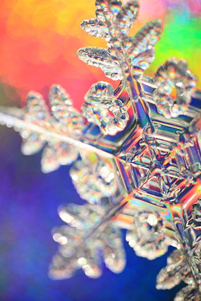 Rainbow background snowflake stock photo