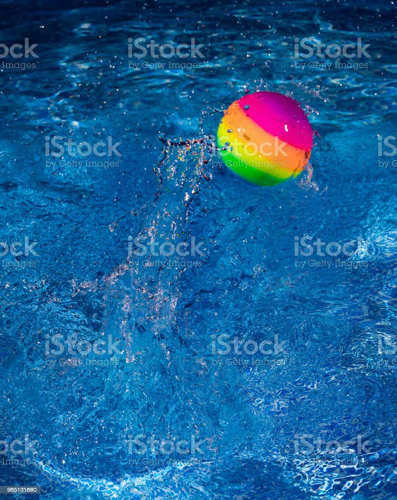 Rainbow ball splash into water zbiór zdjęć royalty-free