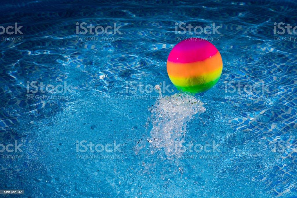 Rainbow ball splash into water zbiór zdjęć royalty-free