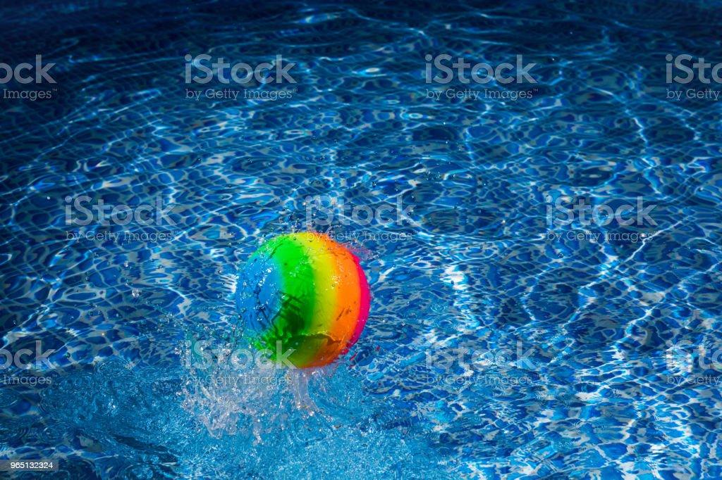 Rainbow ball splash into water royalty-free stock photo