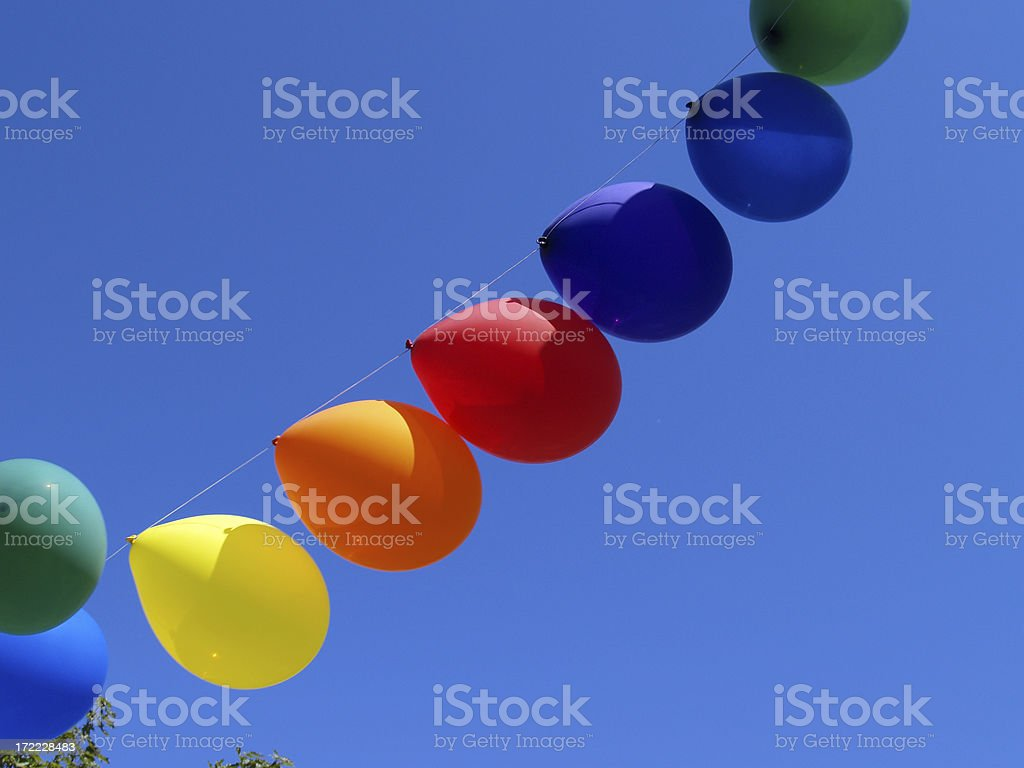 Rainbow balloons against blue sky royalty-free stock photo