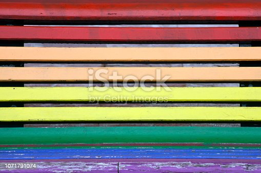 Rainbow bench painted in the colors of LGBT pride flag in Oviedo, Asturias, Spain. Full frame view suitable for background purposes.