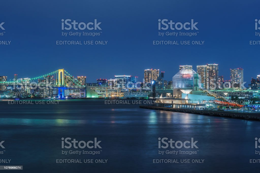 Rainbow Bridge and Harumi Pier (Passenger Ship Terminal) at Night stock photo