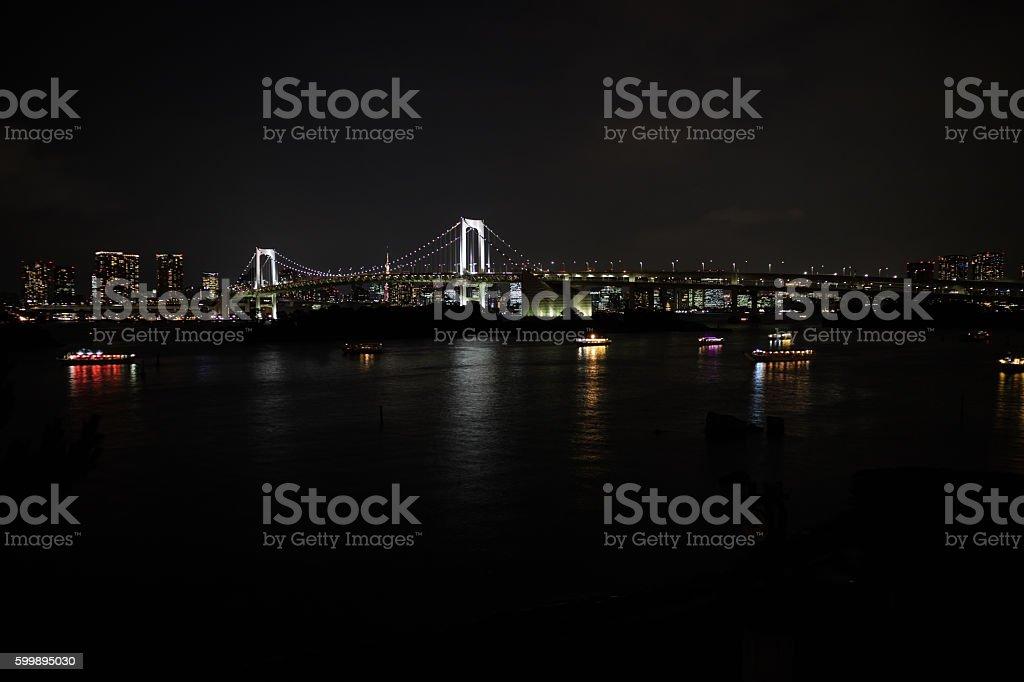 Rainbow bridge at night in Odaiba, Tokyo stock photo