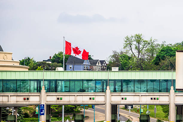 Rainbow Bridge Canada Toll Plaza Canada toll plaza in front of Rainbow Bridge rainbow bridge ontario stock pictures, royalty-free photos & images