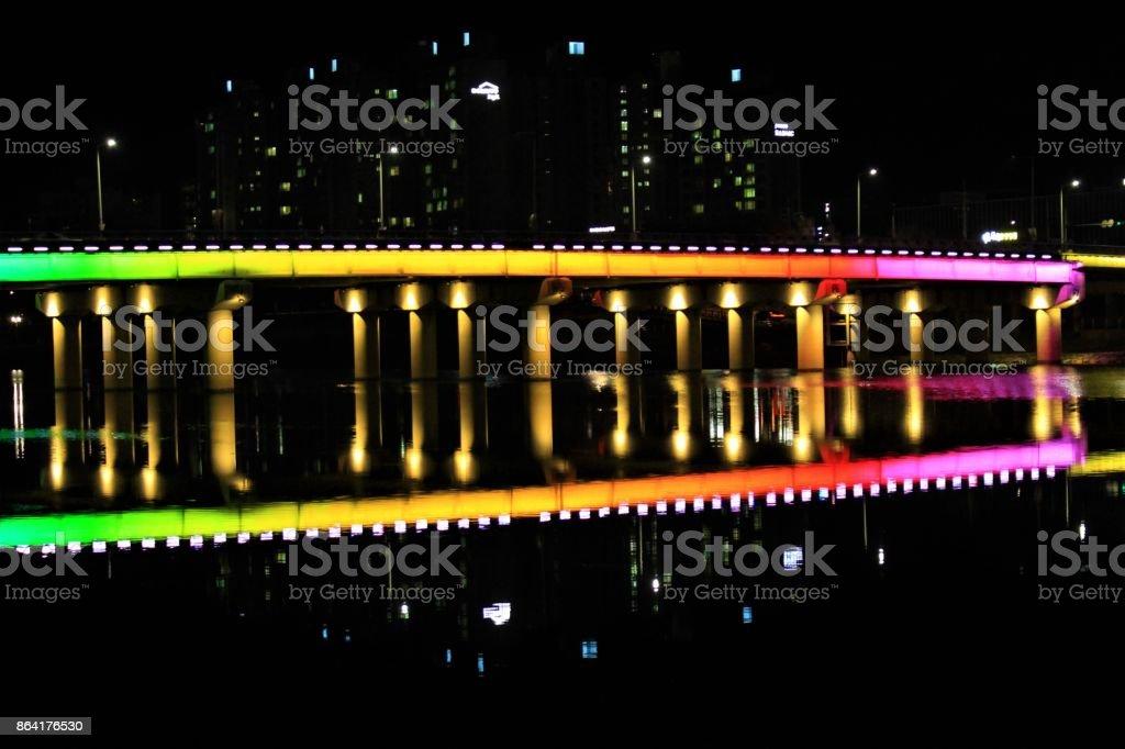 Rainbow Bridge, colorful bridge over a river royalty-free stock photo