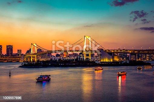 928415496 istock photo rainbow bridge in tokyo, japan 1009557696