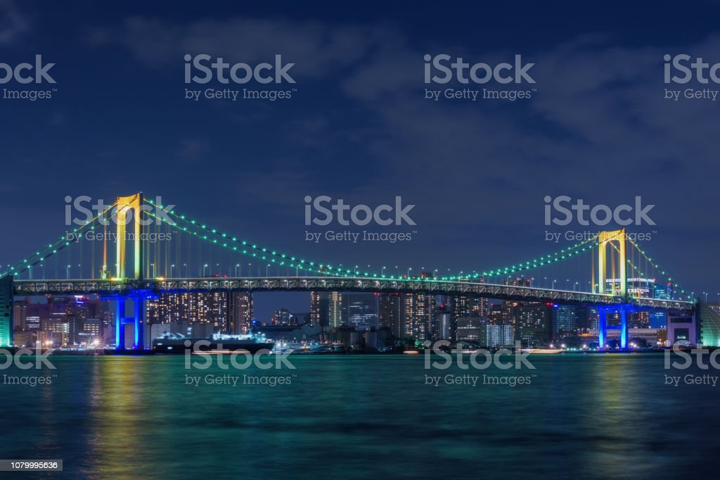 Rainbow Bridge inTokyo at Night stock photo