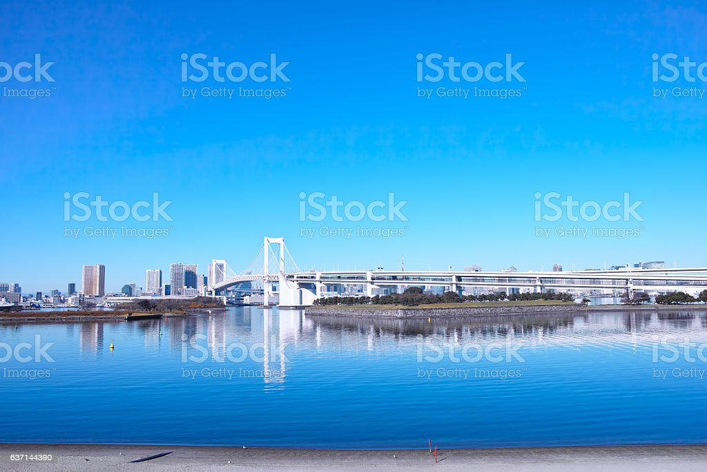 Rainbow bridge overlooking from Odaiba stock photo