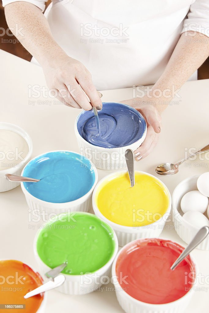 Rainbow Cake: Chef Mixing Color Batter Preparing Layers for Dessert stock photo