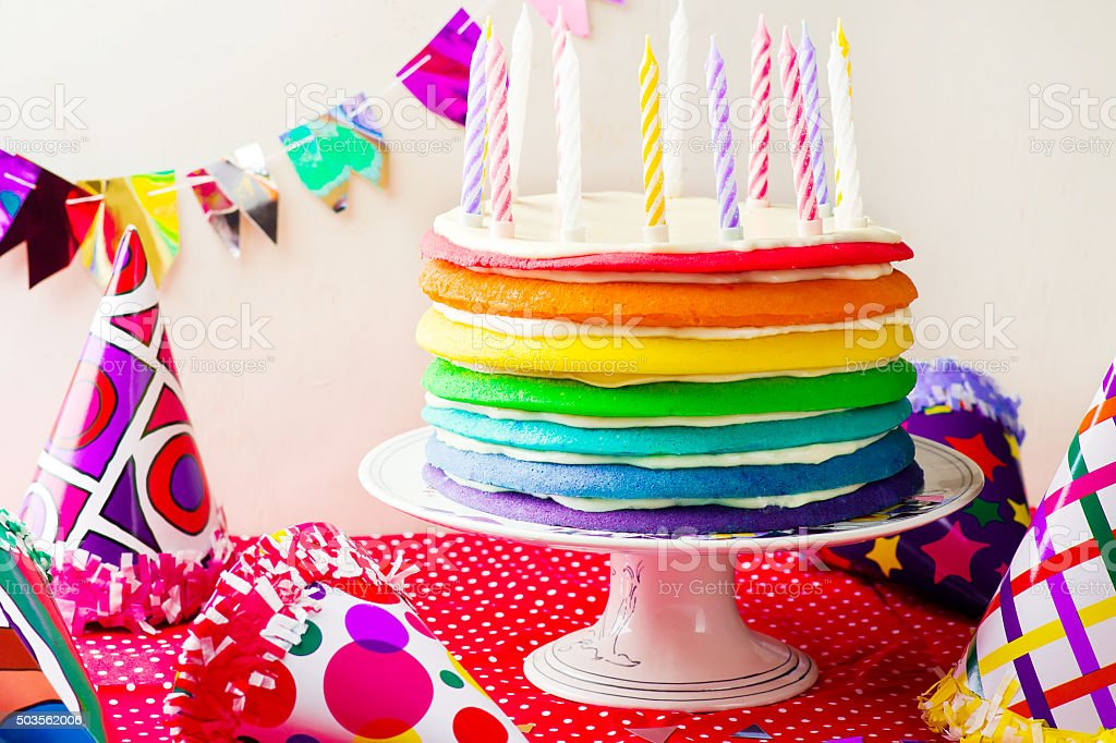 Rainbow cake for  with candles stock photo