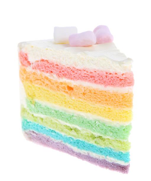 rainbow торт ломтик на белом фоне - кусок торта стоковые фото и изображения