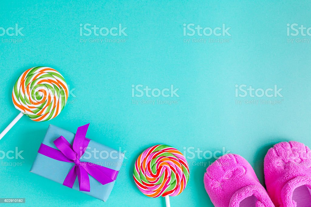 rainbow candy and gift box on blue background stock photo