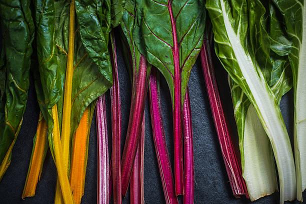 rainbow chard , colorful eating - mangoldgemüse stock-fotos und bilder