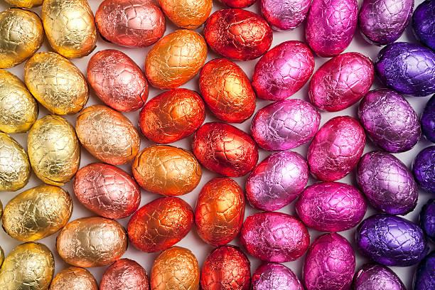Rainbow chocolate Easter eggs stock photo