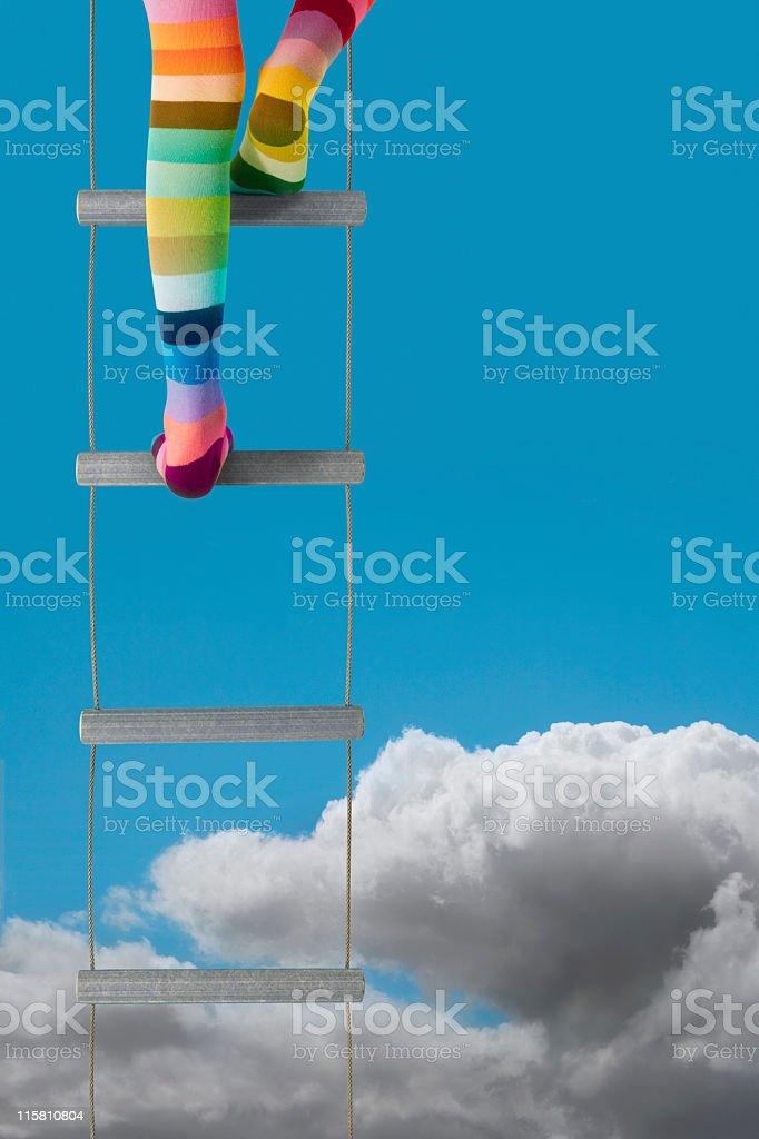 Rainbow climbs above the clouds stock photo
