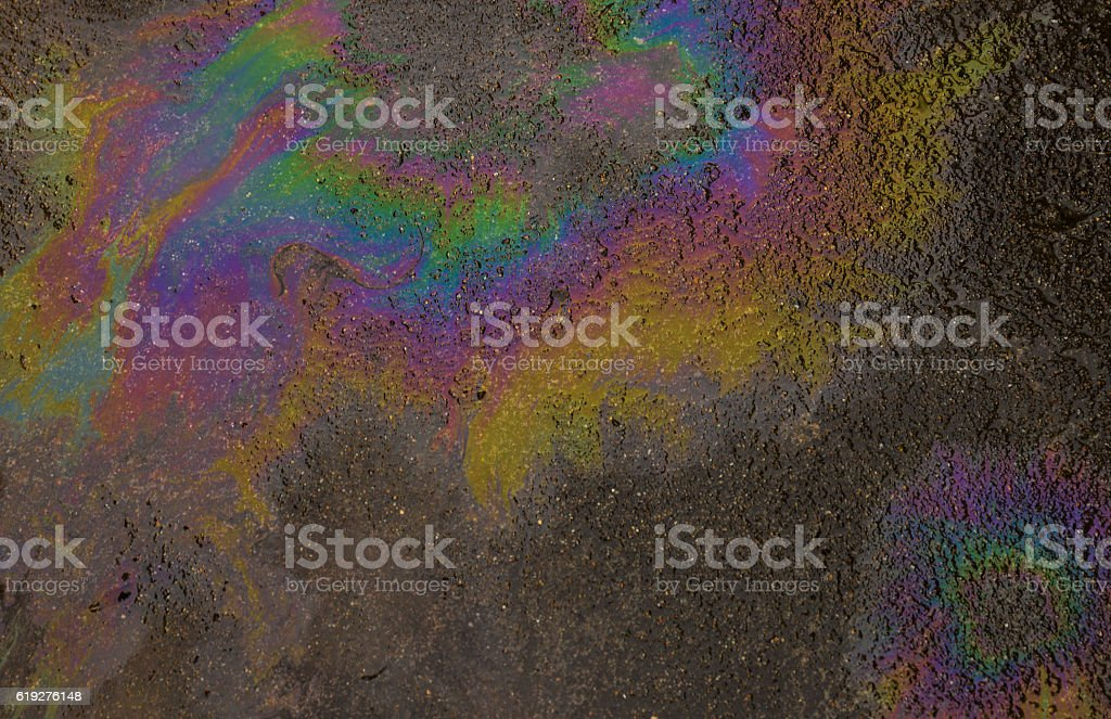 Rainbow color of oil spill on the asphalt stock photo