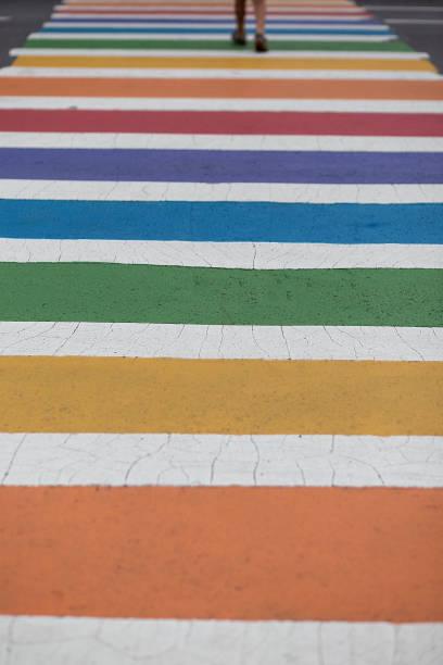 rainbow colored crosswalk stock photo