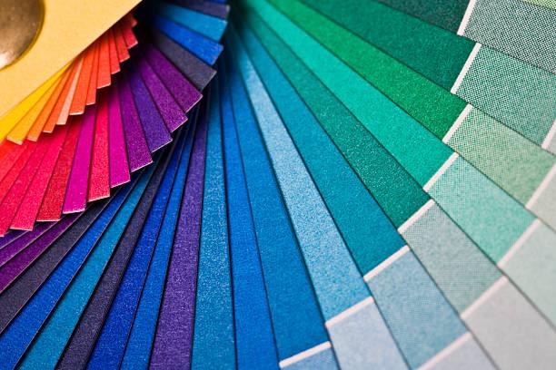rainbow colored fan - kleurenwaaier stockfoto's en -beelden