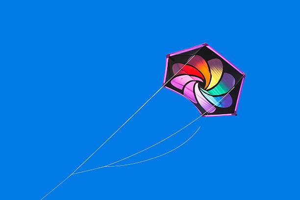 Rainbow colored kite stock photo