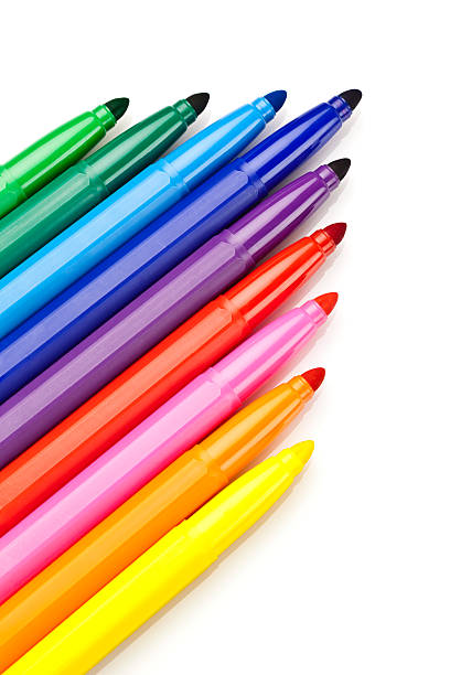 Rainbow colored markers on white background stock photo