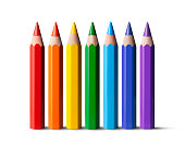 Seven colored pencils on white background.
