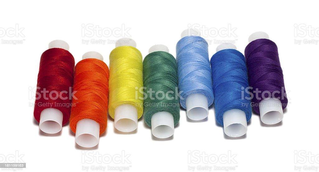 Rainbow colored spools of thread royalty-free stock photo