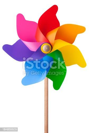 istock Rainbow colored wooden and plastic pinwheel 184855525