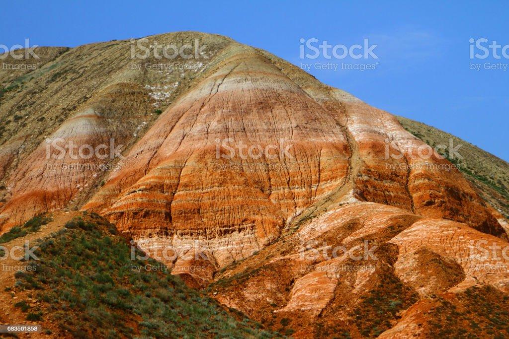 Rainbow colorful eroded slopes stock photo