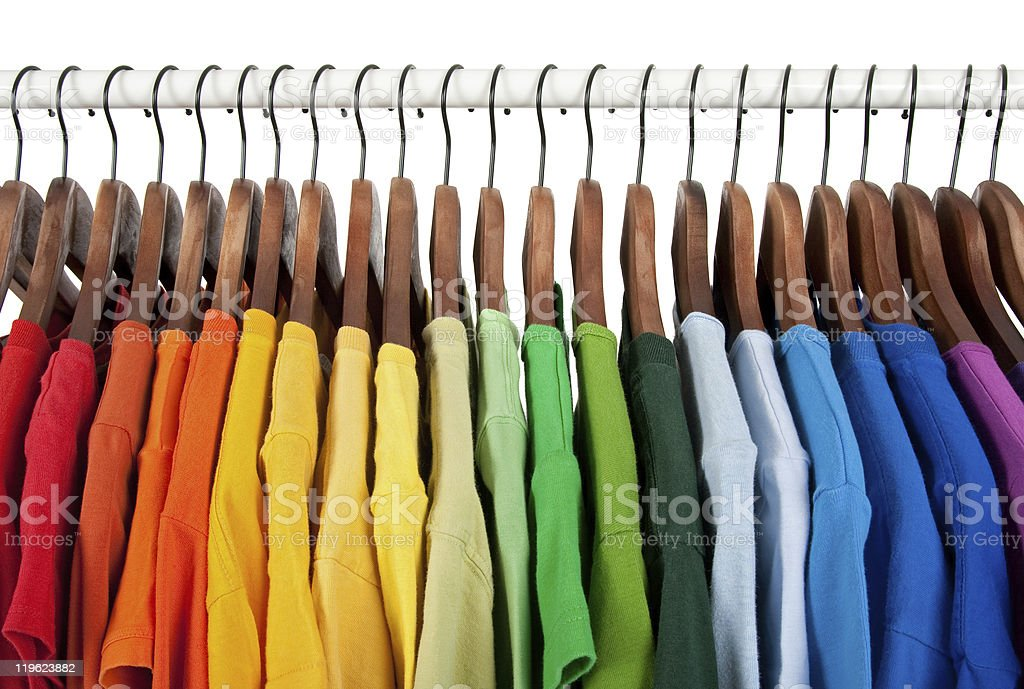 Rainbow colors, clothes on wooden hangers stock photo