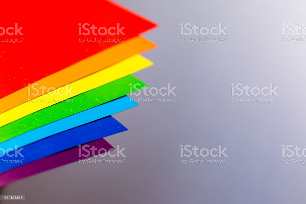 Rainbow Colors With Papers In Brown Table Stock Photo