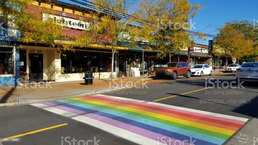 Rainbow Crossing In A Small Town stock photo