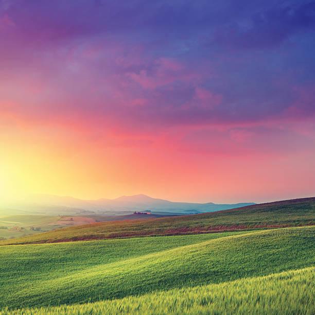 Rainbow dawn in Tuscany stock photo