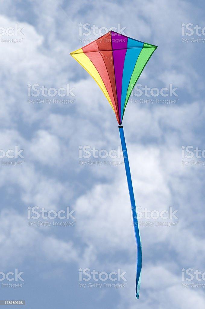 Rainbow Diamond Kite on a Cloudy Sky royalty-free stock photo