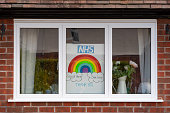 Stafford, England, UK - 2nd April 2020: A picture of a rainbow with the stay home save lives instruction and thank you message to the NHS.