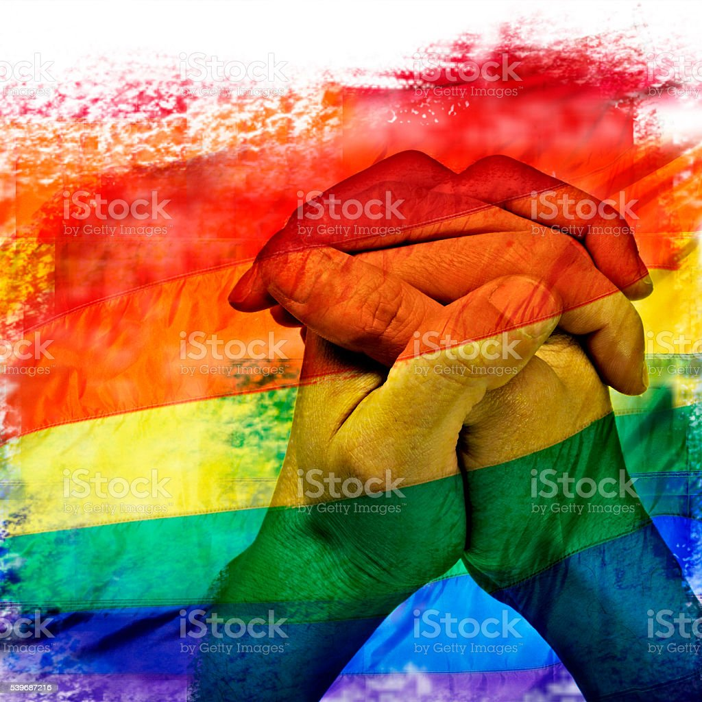 rainbow flag and man hands praying stock photo