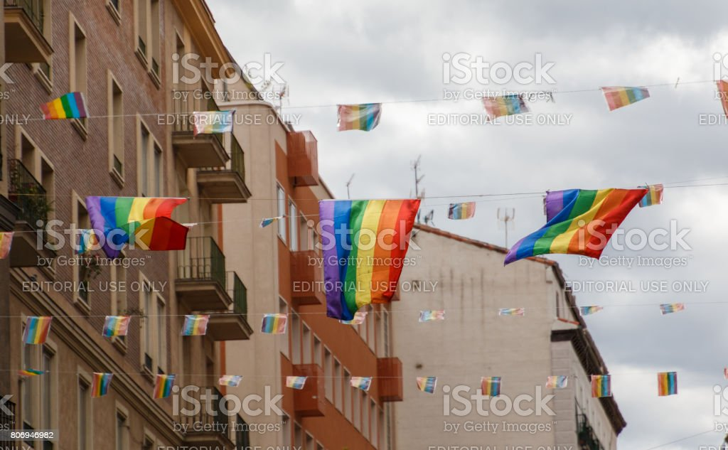 Rainbow flags waving in the wind stock photo