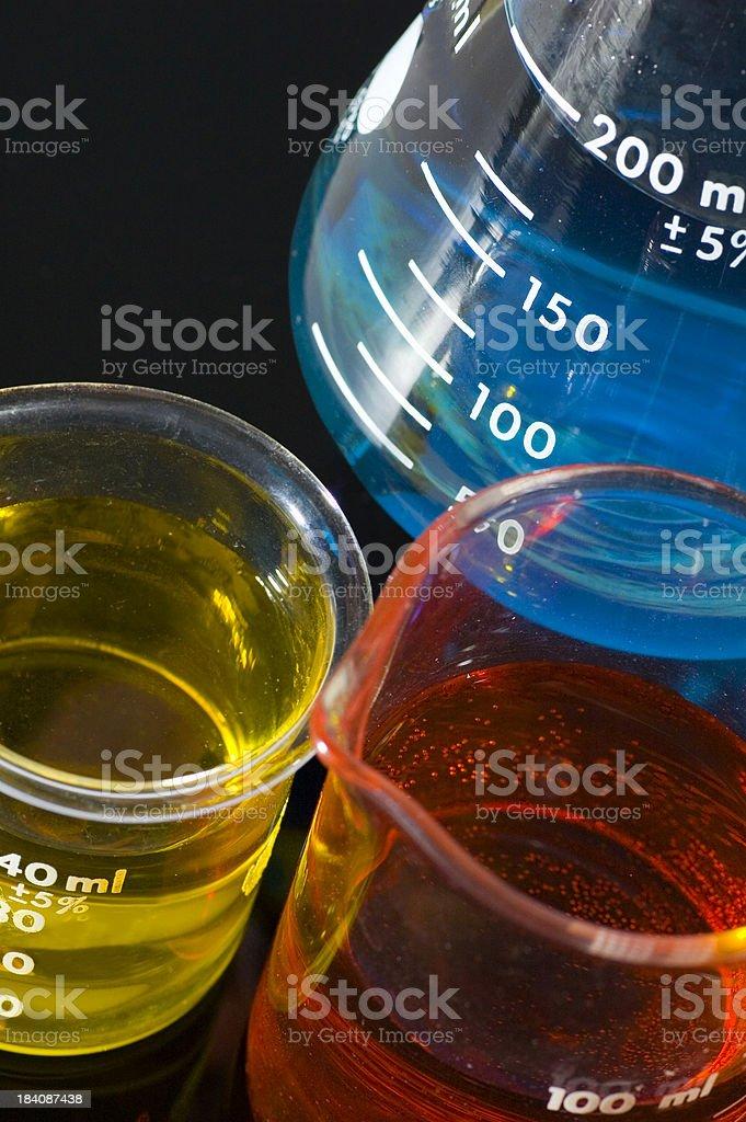 Rainbow Flasks and Beakers on Black royalty-free stock photo