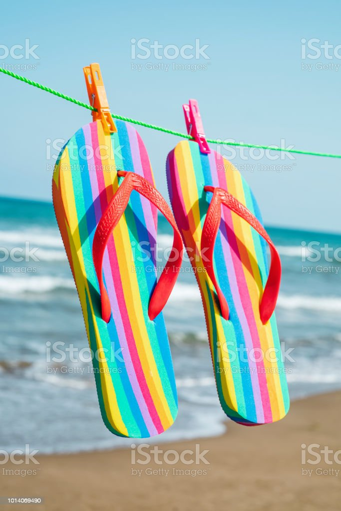 25a47029ec25ec Rainbow Flipflops Hanging On A Clothes Line Stock Photo   More ...