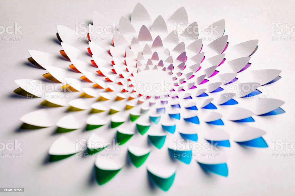 Rainbow flower made of cut paper stock photo