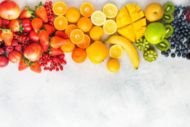 fondo de frutas arco iris - fruta fotografías e imágenes de stock