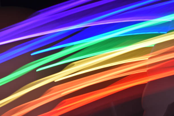 rainbow glow light streaks - steven harrie stock pictures, royalty-free photos & images