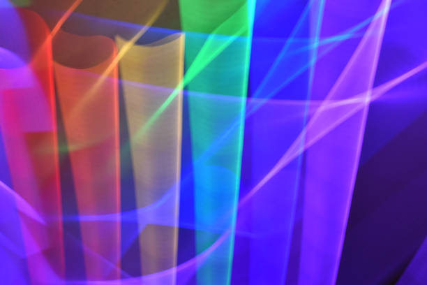 rainbow glow with light streaks - steven harrie stock pictures, royalty-free photos & images