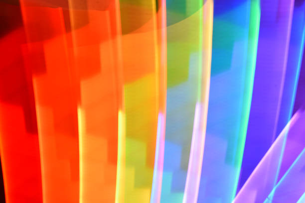 rainbow glowing light streaks - steven harrie stock pictures, royalty-free photos & images