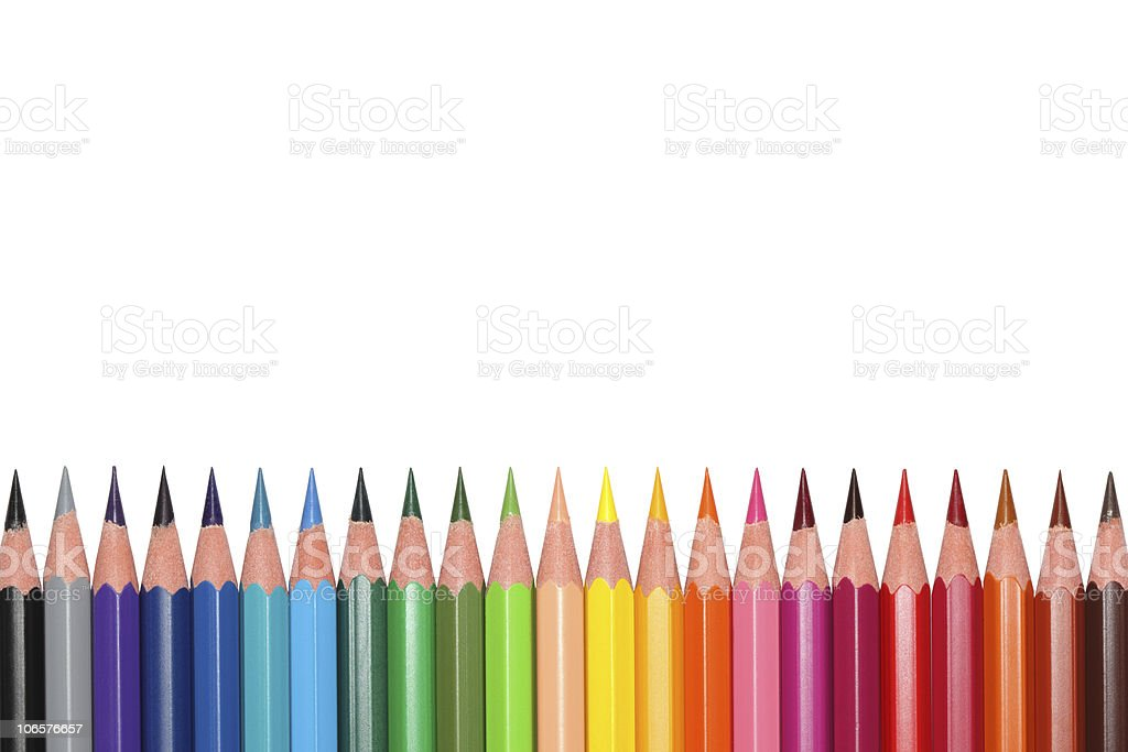 Rainbow gradient row of color pencils on a white background royalty-free stock photo