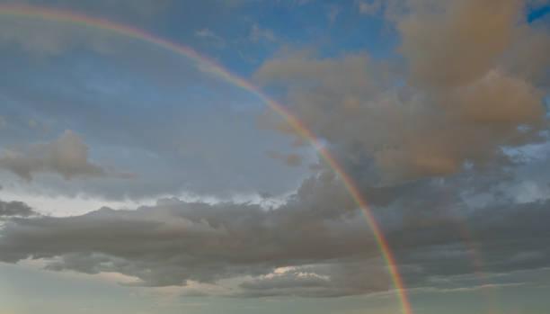 Rainbow in a Dark Sky stock photo