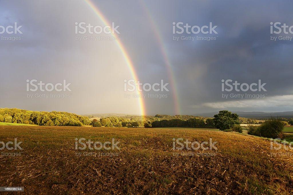 rainbow in rural setting stock photo