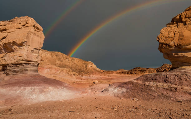 Rainbow in stone desert Volcanic landscape in geological Timna park, Israel.  It is located 25 km north of Eilat and combines beautiful scenery with unique geology, variety of sport and family activities negev stock pictures, royalty-free photos & images